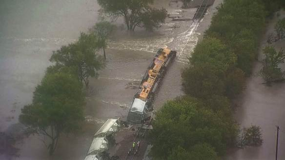 Credit: NBC Train derailed by flood waters near Dallas, TX