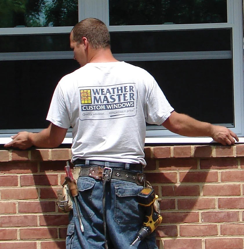Weathermaster Window's professional installer finishing up a project