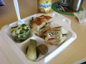 Turkey Pastrami Bagel Sandwich with Cucumber Salad at Greenfield's Bagels