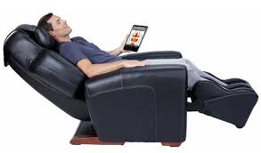 person sitting on recliner chair