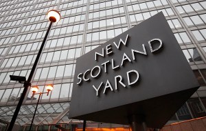 New Scotland Yard police headquarters is seen in London January 27, 2011. British police opened a new investigation on Wednesday into allegations of phone hacking after the country's top-selling tabloid newspaper sacked one of its senior editors.  REUTERS/Suzanne Plunkett (BRITAIN - Tags: SOCIETY POLITICS CRIME LAW CITYSCAPE)