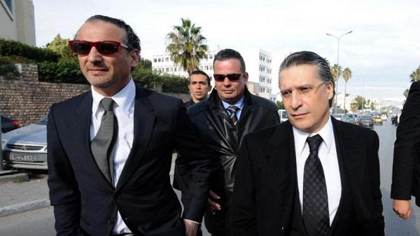 Ghazi et Nabil Karoui, photo AFP/Fethi Belaid