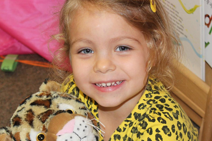 Girl with stuffed animal - Webster Child Care Center