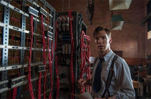 "Benedict Cumberbatch as Alan Turing next to his ""Turing machine."""