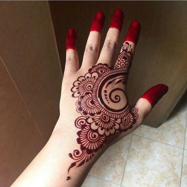 14. Red Mehndi back hand design