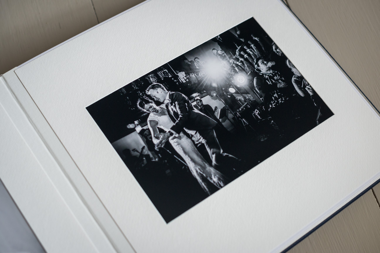 page in square matted wedding album