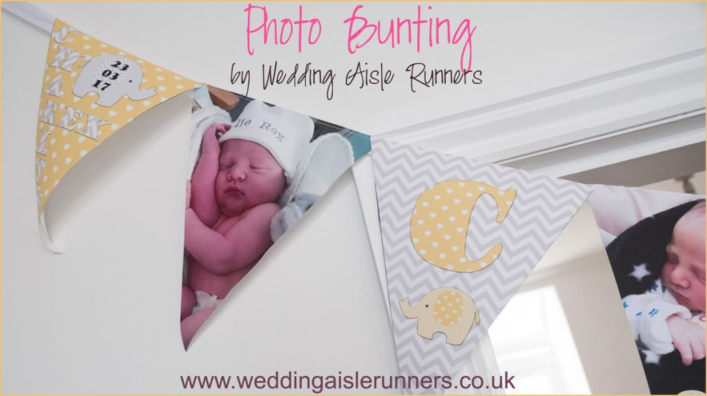 new baby photo bunting by wedding aisle runners