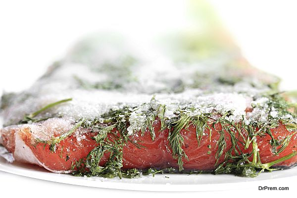 Marinated salmon with dill and black peppe.
