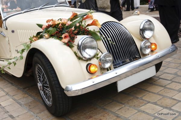 Vintage Wedding Car Decorated with Flowers.