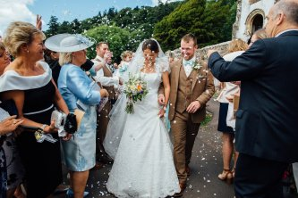 Brides leaving with Bouquet