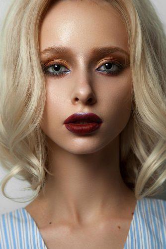 fall wedding makeup orange eyeshadows dark red lips blue eyeliner muaclub
