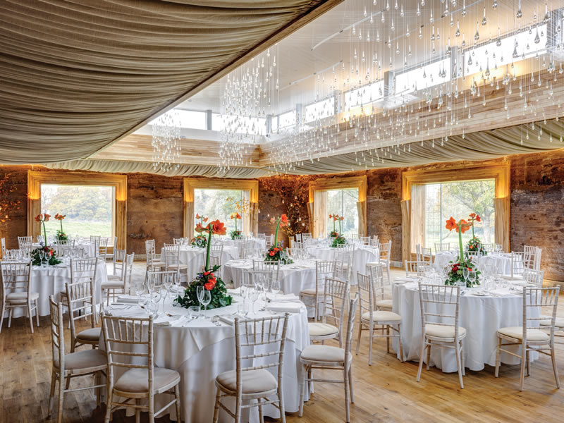 Designed to evoke romance, fall in love with these UK rustic barn venues offering quirky outbuildings, festival yurts and miles of coastal country views!