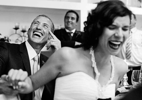 Couple laughing at wedding speech