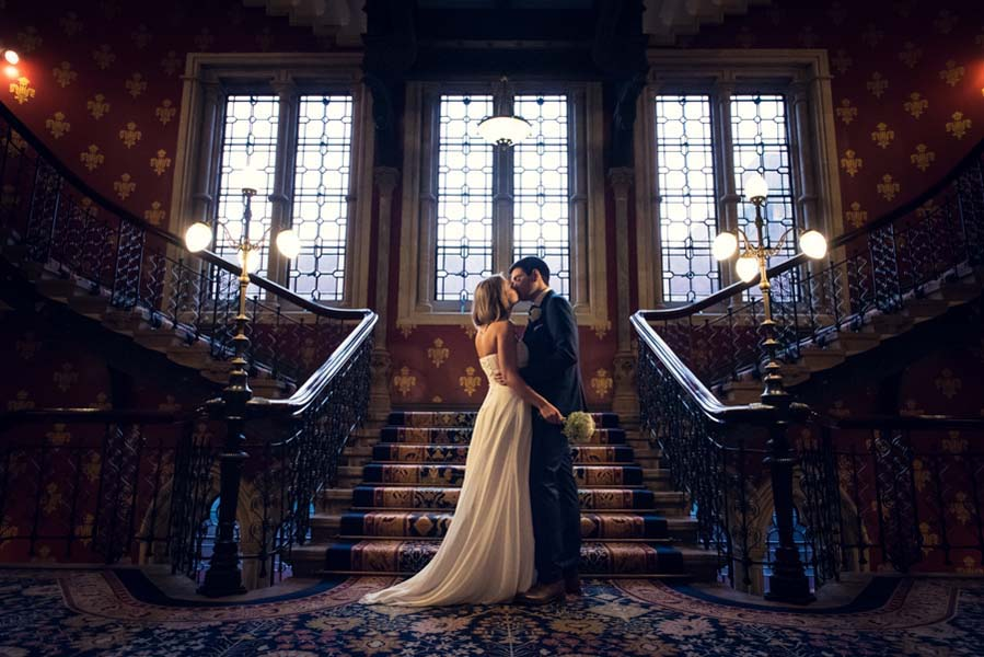 bride and groom posing at a beautiful staircase
