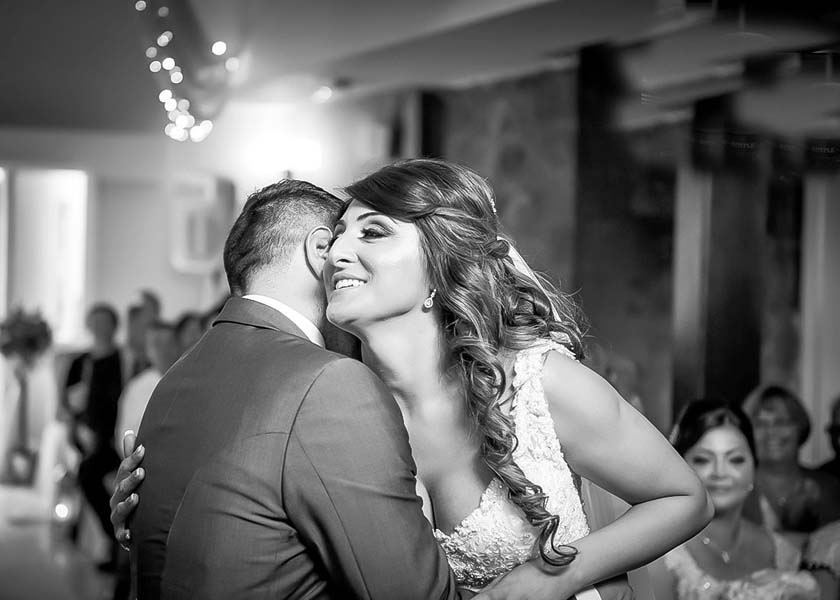 Bride and groom hug at Stirk House Hotel