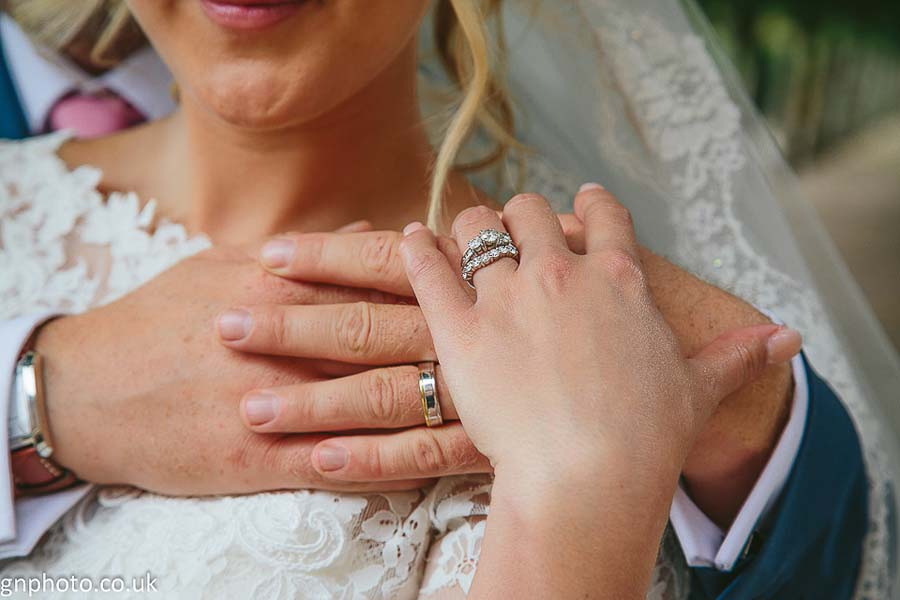 holding hands at Thornton Manor wedding