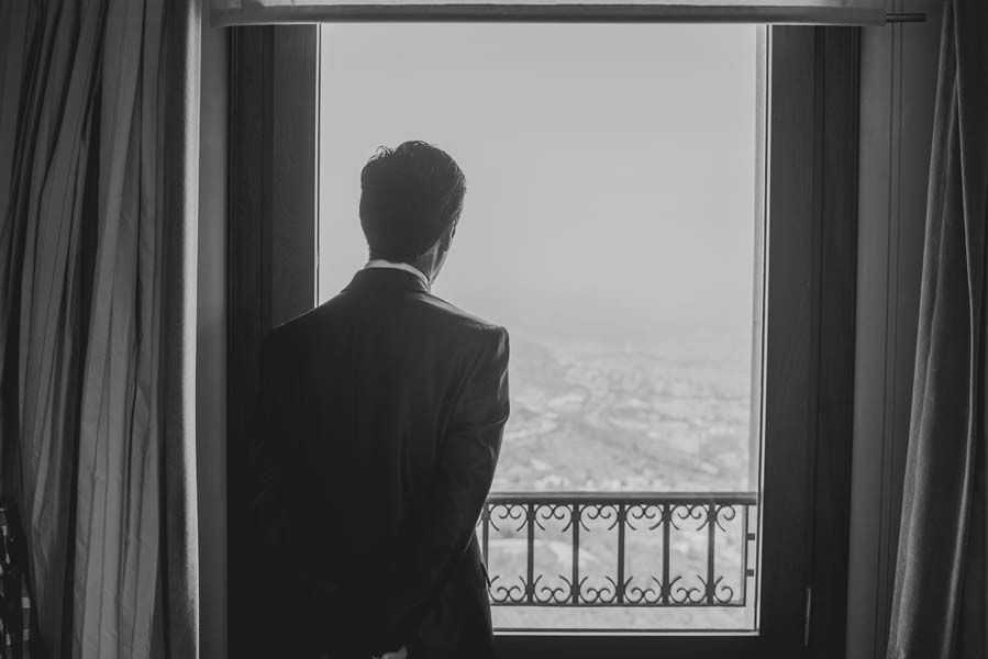 Groom looking out of window