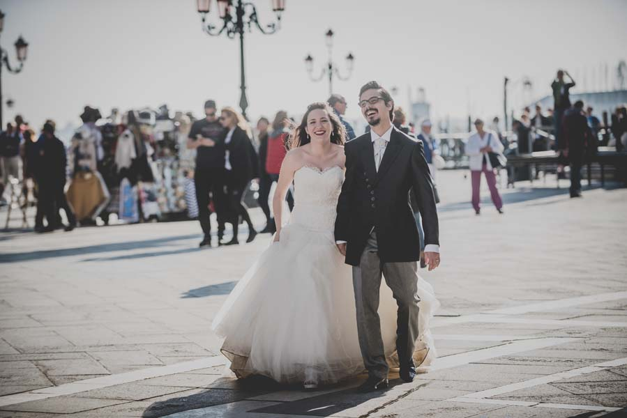 bride and groom walk the streets