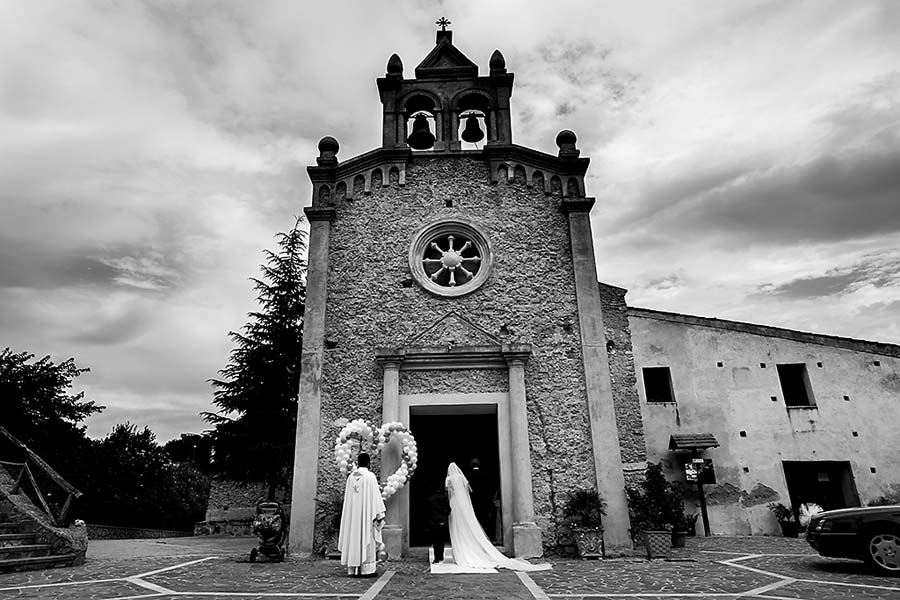 Bride and bridesmaids outside church in Italy
