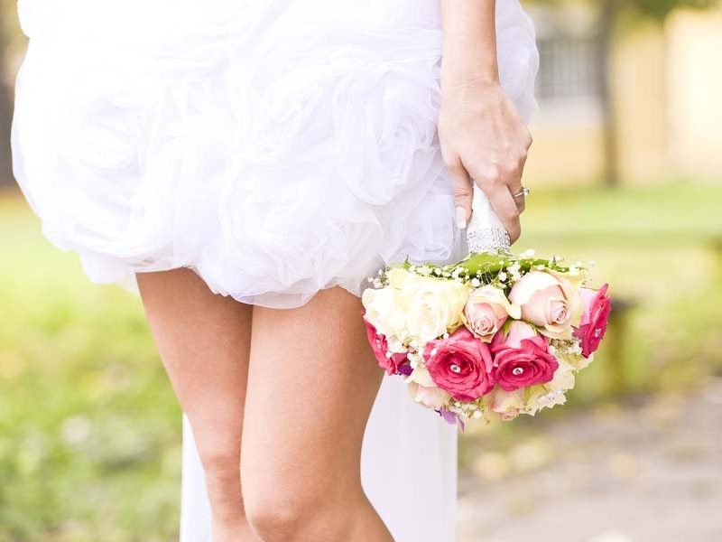 Young Bride Holding Bouquet