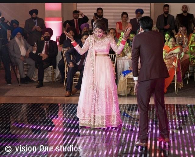 beautiful Sikh wedding by Vision One Studios pink lehenga