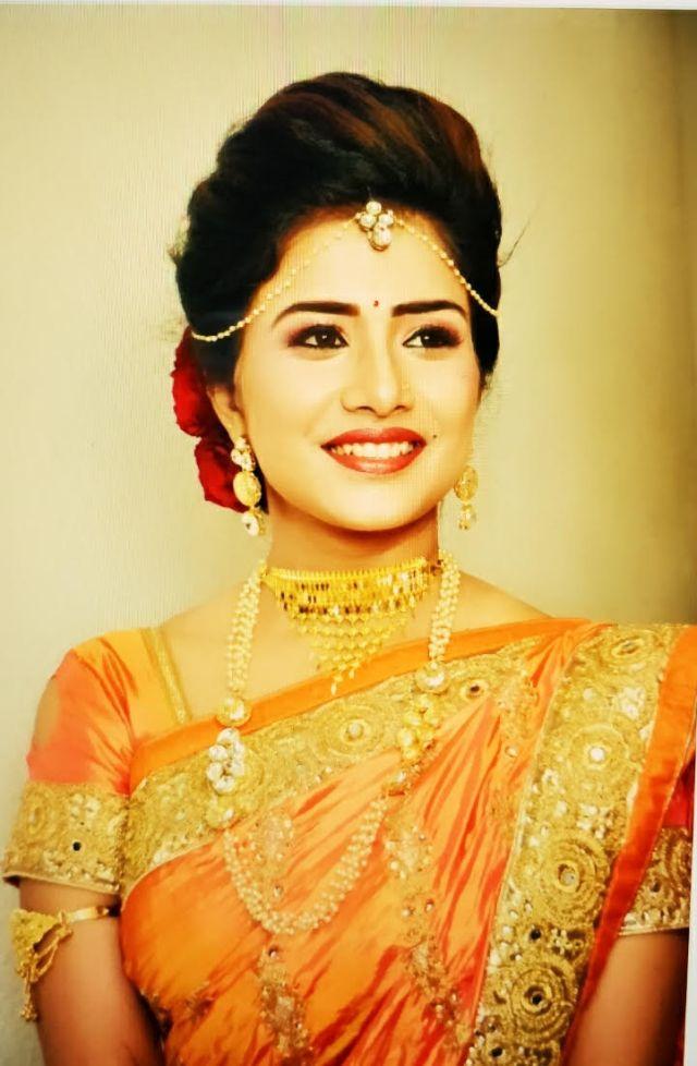 beautiful bride in gorgeous golden orange sari and beautiful traditional jewelry