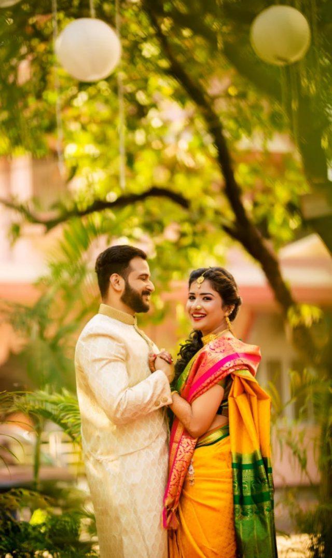 beautiful Maharashtrian real wedding Wedding Leaves Photography beautiful green pink paithani sari