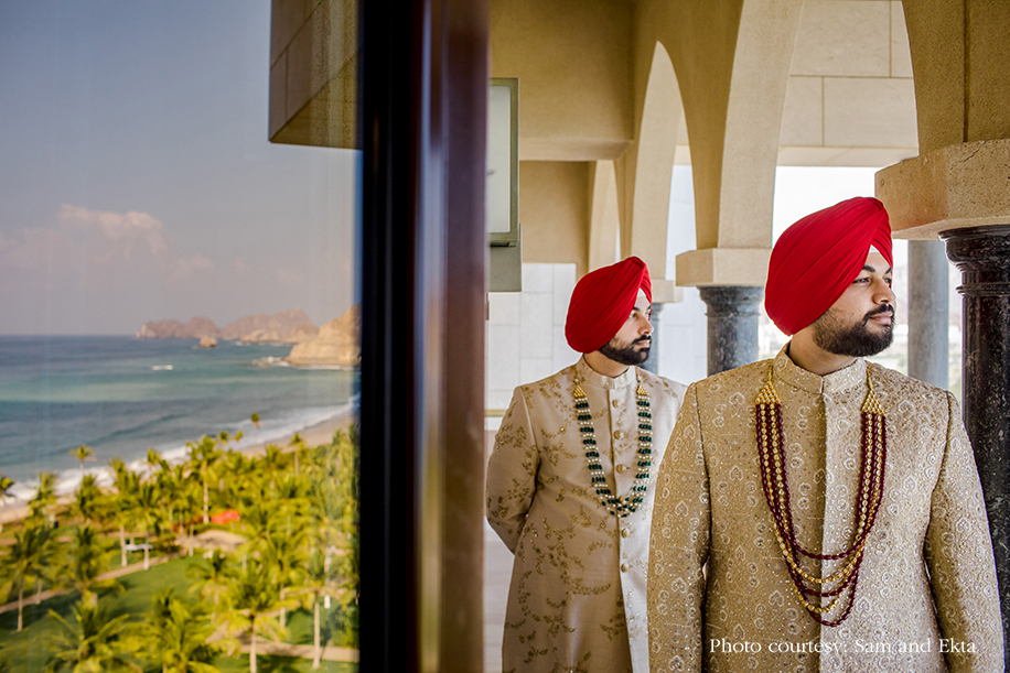 Groom in gold sherwani and red turban