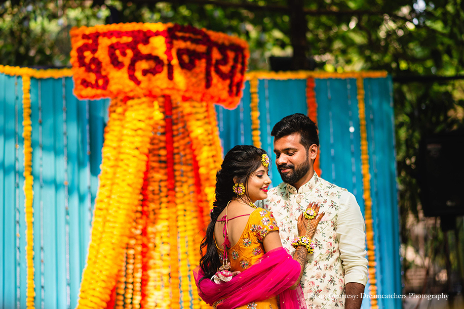 bride in vibrant yellow lehenga and groom in floral Nehru Jacket from Maanyavar
