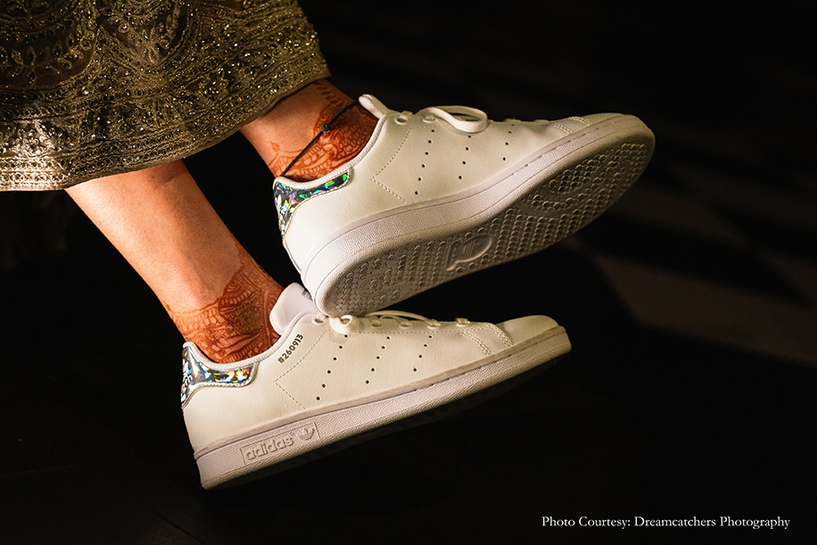 Bride wearing Adidas Stan Smiths for her cocktail