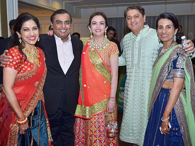AA The Grooms mother and bride's parents with Nita and Mukesh Ambani