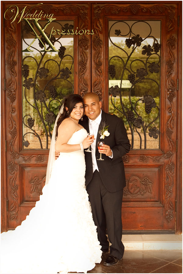 wedding couple in front of winery door