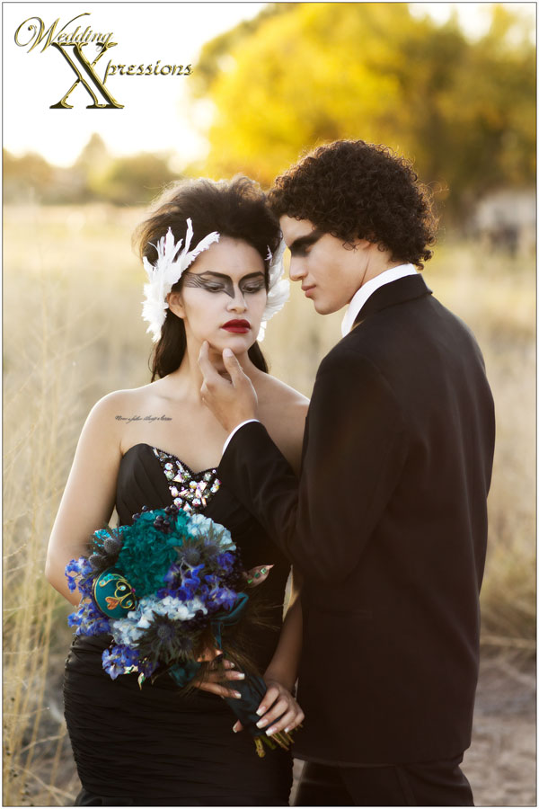 bride and groom wearing black wedding dress