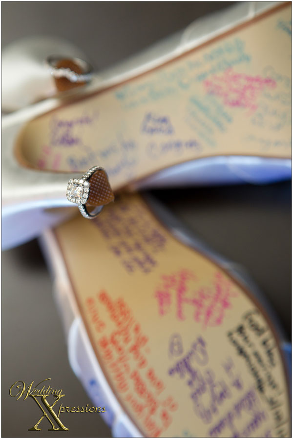 engagement and wedding ring on brides wedding shoes