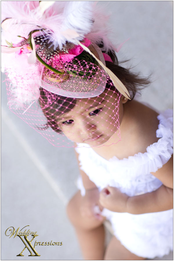 baby with big pink hat