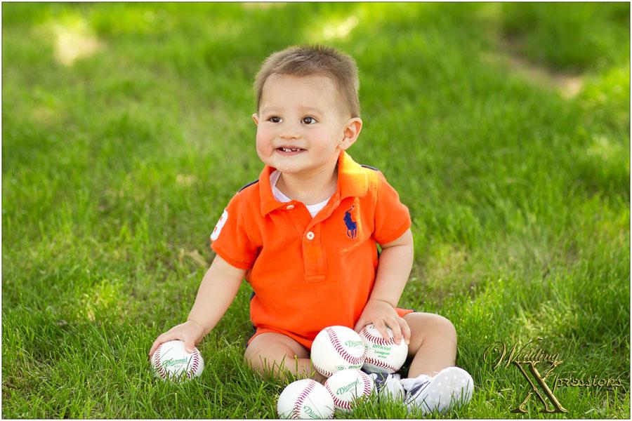 baby with baseballs