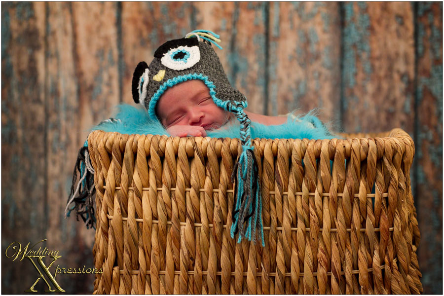 baby photography with blue hat