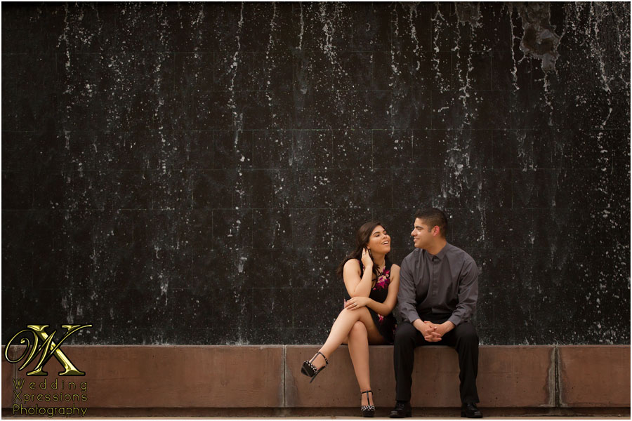 engaged couple in front of waterfall in El Paso