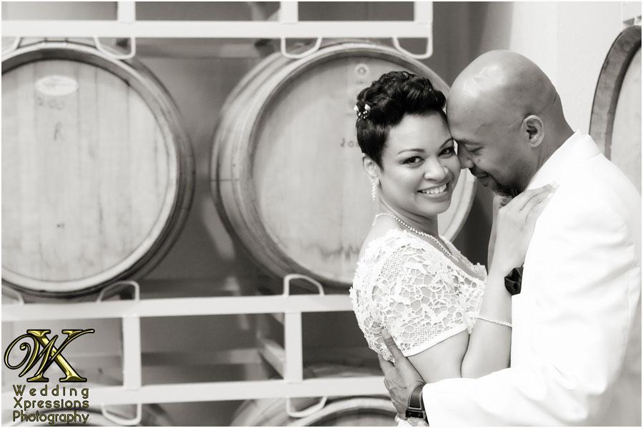 wedding couple and wine barrels