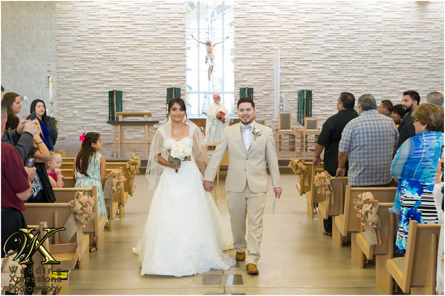bride and groom walking out of church ceremony
