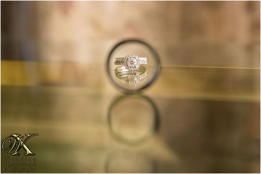 bride's rings through grooms ring