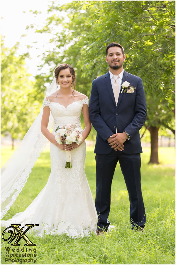 bride and groom standing