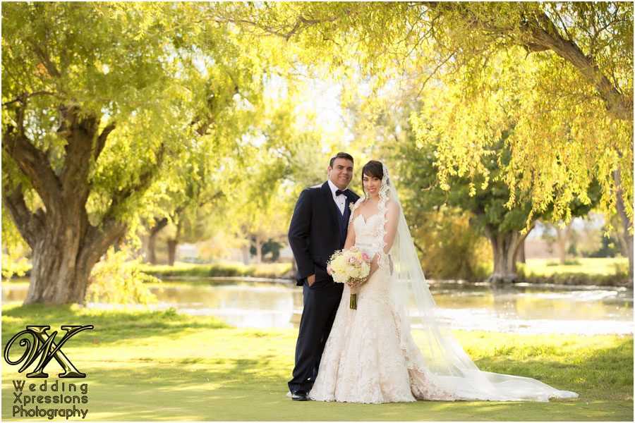 wedding photography in El Paso of couple in front of beautiful lake