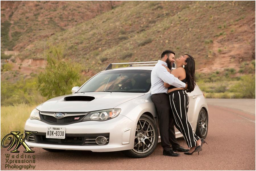 engaged couple with Subaru car