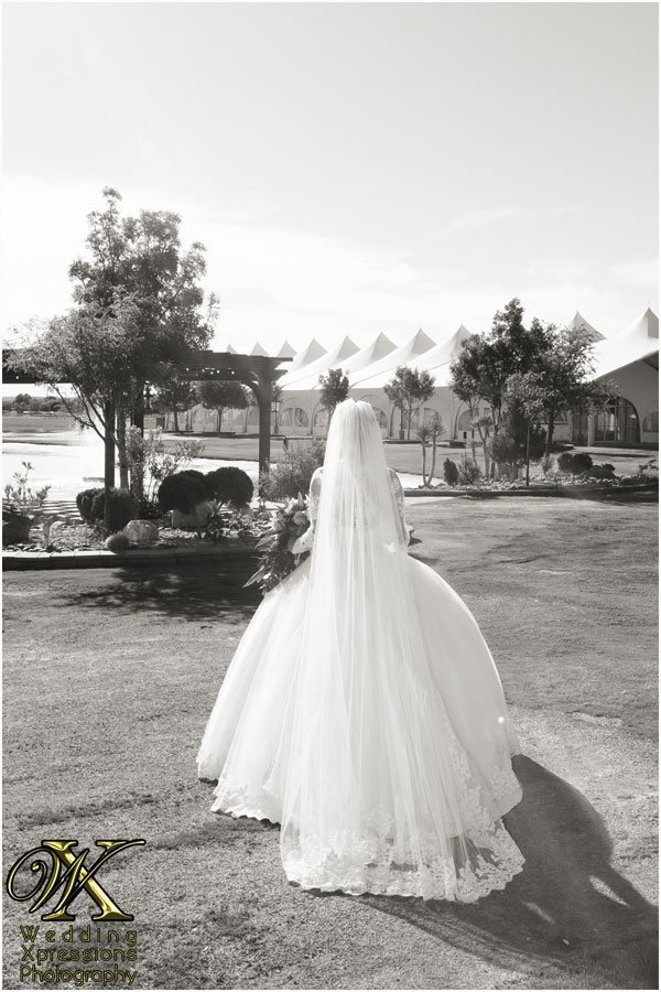 bride walking to wedding ceremony at Grace Gardens
