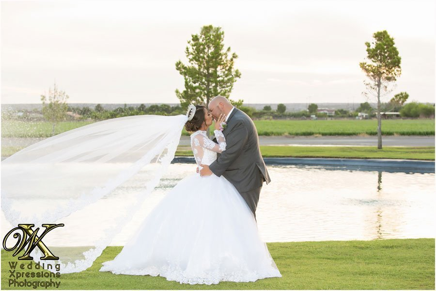 wedding couple at Grace Gardens pond photographed by Wedding Xpressions Photography