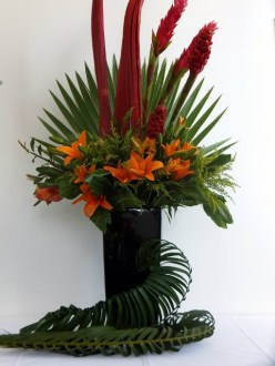 corporate arrangement of braided palm leaves fan palm palm husks ginger flower and asiatics from 200 480x640