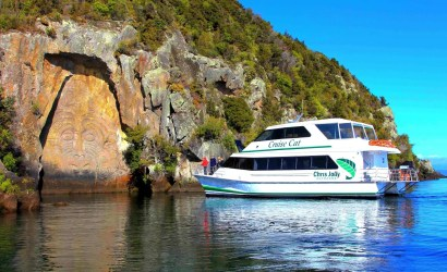 Chris Jolly Outdoor's boat cruise cat in front of the Maori Carvings Taupo New Zealand