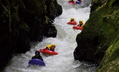 Group of river sledgers float through a narrow gorge on Kaituna River