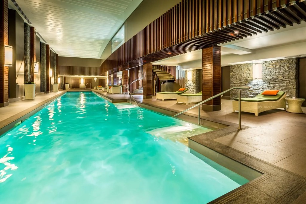 Hilton Queenstown pool area with lap pool and relaxation chair